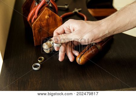 The Man The Jeweler Chooses The Form For Manufacturing Of A Ring