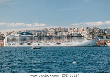 ISTANBUL TURKEY - NOVEMBER 17 2013: The majestic cruise ship MSC (magnifica) leaves the port traveling with onboard cruise passengers