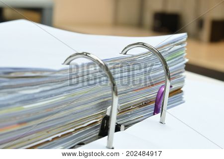 Pile of financial documents in document file on desk at workplace,business concept.
