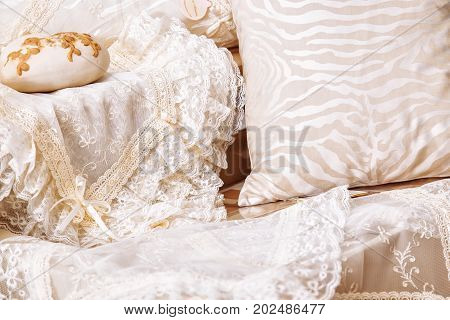 Home Textiles. Various Pillows And Bedspreads