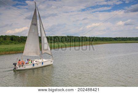 Sniardwy Lake, Poland-JUNE 232008:Small yacht sailing accross Sniardwy Lake, Mazurian Region, Poland, Europe