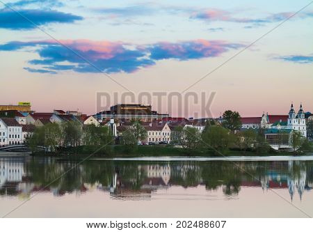 Minsk, BELARUS-MAY 112017:Old town of Minsk in sunset soft light with Niemen River in foreground, Belarus, Europe