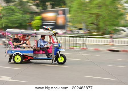 BANGKOK, THAILAND - January 21:A three wheeled Tuk Tuk taxi or three wheel bike on a street in the Thai capital ,which is a famous traditional taxi.on January 21, 2017 in Bangkok, Thailand.