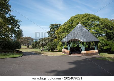 SYDNEY,NSW,AUSTRALIA-NOVEMBER 20,2016:  Pergola at the Royal Botanic Gardens with tourists on the paths and view of Farm Cove in Sydney, Australia