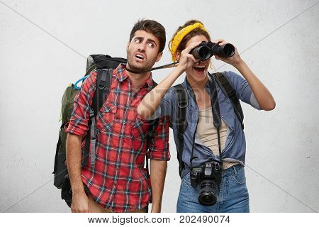 Young European Couple On Safari Trip: Happy Woman Using Binoculars While Examining Area, Pulling Str