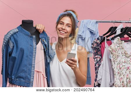 Happy Woman With Appealing Appearance, Standing Near Mannequin, Having Joyful Expression While Being