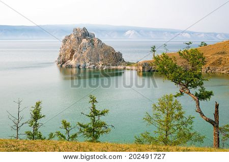 View of Shamanka rock, Cape Burhan on Olkhon island. Lake Baikal, Siberia, Russia