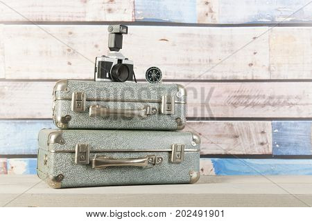 Vintage travel with old suitcases, photo camera and compass
