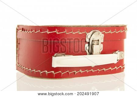 Little red toy suitcase isolated over white background