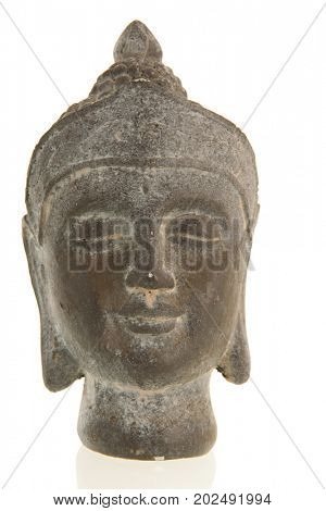Old stone head of Buddha isolated over white background