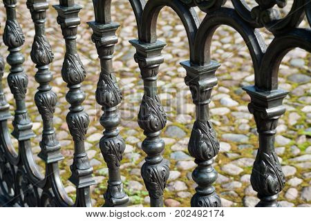 Beautiful decorative metal fence close up. Art background.