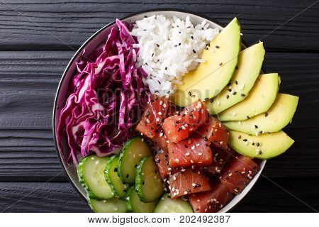 Hawaiian Tuna Poke Bowl With Avocado, Red Cabbage, Cucumber And Sesame Seeds. Horizontal Top View