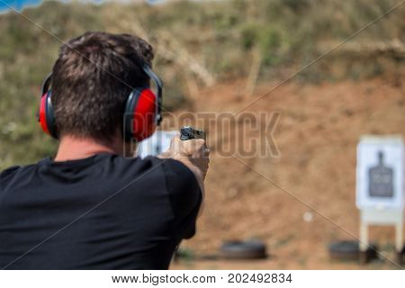 Young And Handsome Muscular Caucasian Policeman Professional Army Special Force Training On The Batt