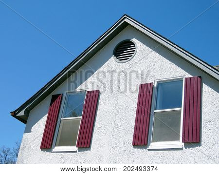 Windows with red shutters in Thornhill Canada April 17 2017