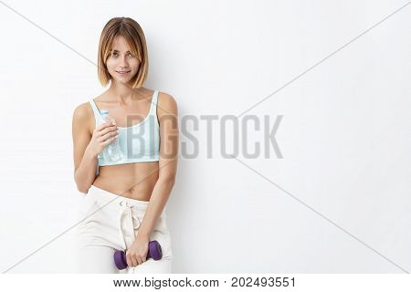 Athletic Female Going In For Sport, Keeping In Hands Necesary Equipment While Going To Gym. Student