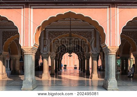 JAIPUR RAJASTHAN INDIA - MARCH 10 2016: Horizontal picture of ornated pillars with amazing architecture inside of City Palace in Jaipur known as pink city of Rajasthan in India.
