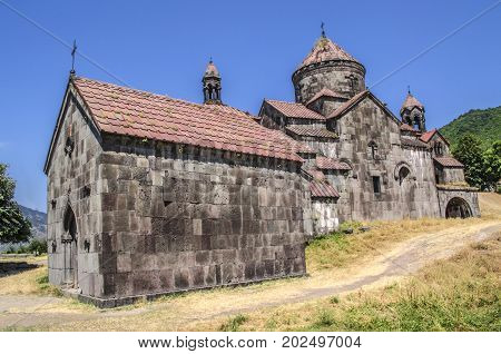 Side view of the monastery Gregory the Illuminator and the gavit of St.Nshan in the Armenian village of Haghpat