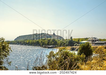 Alpine lake Sevan and of the peninsula with views of the Church of the Holy Apostles