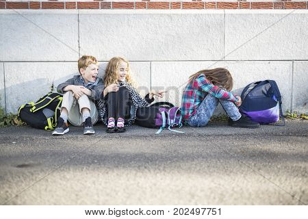primary students boy outside at school standing
