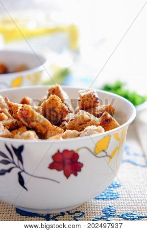 Pieces of rusks in a light cup on the table.