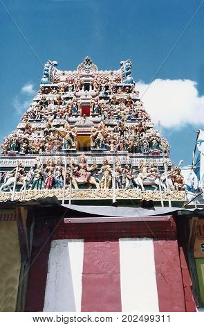SINGAPORE / CIRCA 1990: The historic Sri Veeramakaliamman Temple, dedicated to the Hindu goddess Kali, is in the middle of Little India in the southern part of Singapore.
