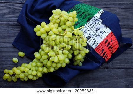 Green fresh grapes in the Italian background