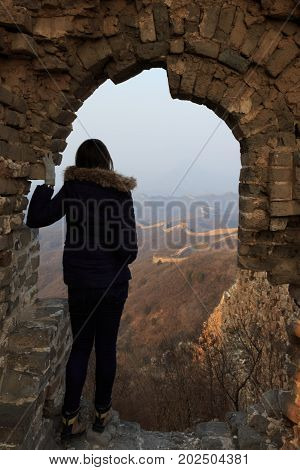Tourist At A Tower Of The Great Wall Of China. The Great Wall Of China Is The World's Longest Wall A