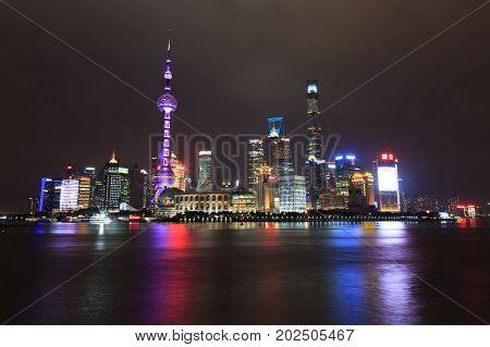 Shanghai China - November 29, 2016:  Pudong District Skyscrapers At Night In Shanghai China. Pudong