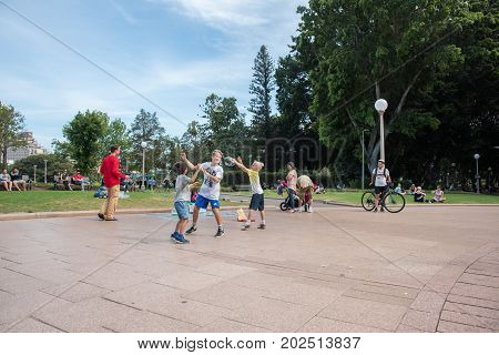 SYDNEY,NSW,AUSTRALIA-NOVEMBER 20,2016: Street busker and children playing with bubbles in Hyde Park in Sydney, Australia.