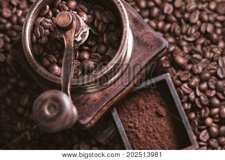 Grinding coffee from fresh roasted coffee beans.
