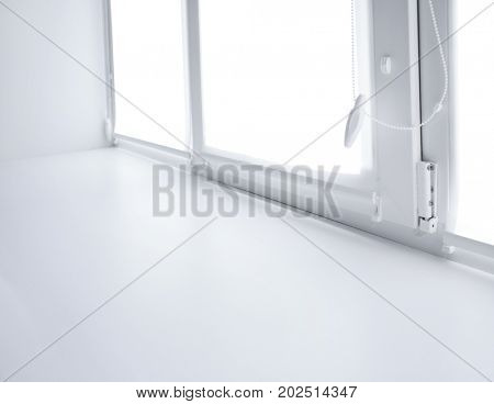 Modern white plastic window sill