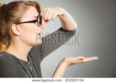 Girl Pinches Her Nose Because Of Stench Stink.