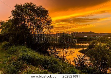 Golden Sunset Over A River