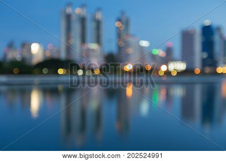 Night twilight blurred bokeh light city downtown and reflection abstract background