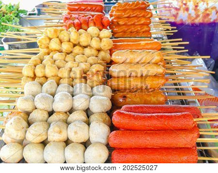 Sausage sticks and various meatballs sticks made from pork fish chicken Thai fast food