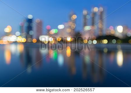Reflection blurred bokeh light city office building downtown abstract background