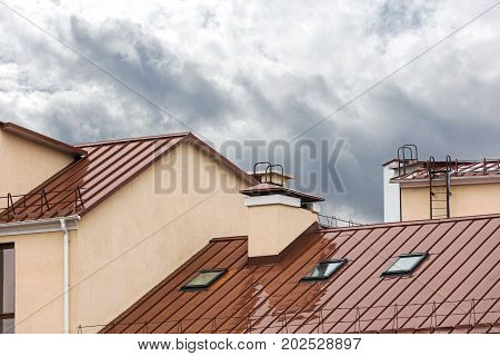 Wet Red Metal Roof With Skylights During Rain