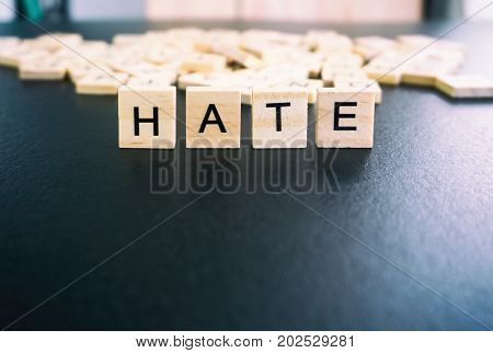 Hate Words On A Wood Blocks, Focus On The Foreground With Filter And Analog Effect