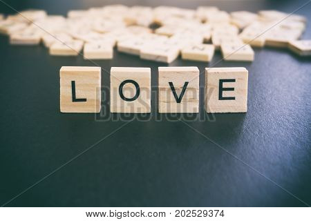 Love Words On A Wood Blocks, Focus On The Foreground With Filter And Analog Effect