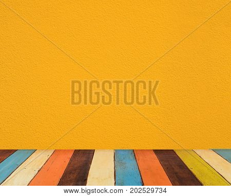 yellow cement wall with colorful retro painted wooden floor