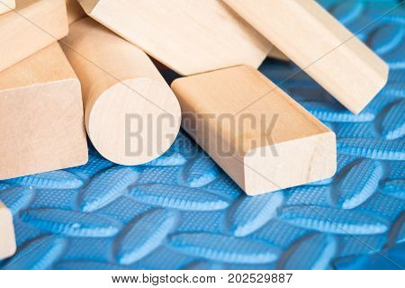 wooden toys or wooden blocks on blue mat