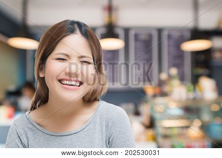 happy self-employed woman with bakery shop background