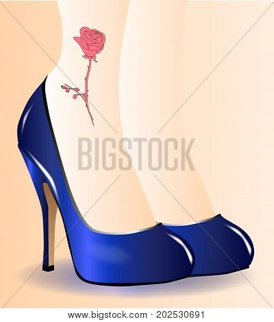 A pair of ladies legs with a red rose tattoo iwith blue stiletto heal shoes