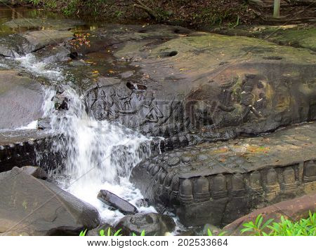 Riverbed and watterfall carving at Kbal Spean Khmer relics in Angkor temple area in Cambodia