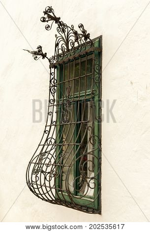 Wrought iron window grille on an old house in Austria