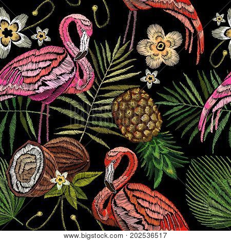 Embroidery flamingo palm tree leaves pineapple coconut tropical seamless pattern. Fashionable embroidery pink flamingos tropical summer background. Fashionable template for design of clothes