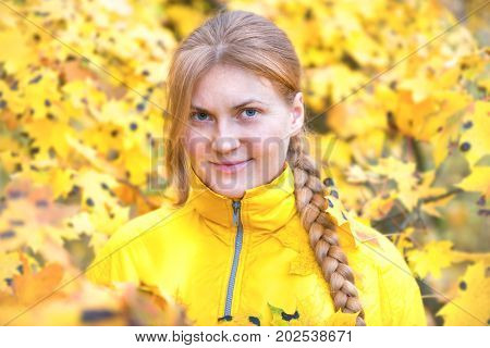 Pretty Woman With In The Autumn Park
