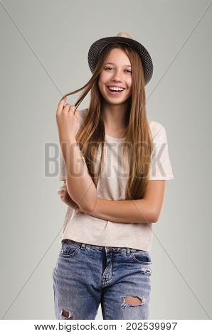 Positive Casual Woman Posing. Emotional Girl Portrait. Young Female With Hat. The Model Is Looking A