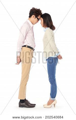 Side view of business couple touching their foreheads