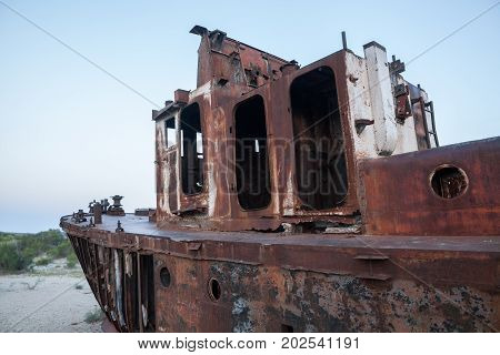 Color image of a wrecked ship on the former banks of the Aral sea in Moynaq Uzbekistan.